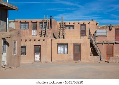 Acoma Pueblo historic adobe homes, doors and wooden ladders. Acoma Pueblo is also called Sky City in New Mexico.
