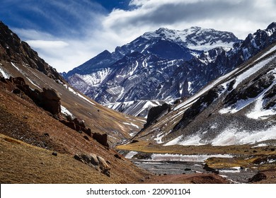 Aconcagua Peak. Aconcagua is the highest mountain in America and the Western and Southern Hemispheres at 6,960.8 metres. It is located in the Andes mountain range, in Mendoza, Argentina.