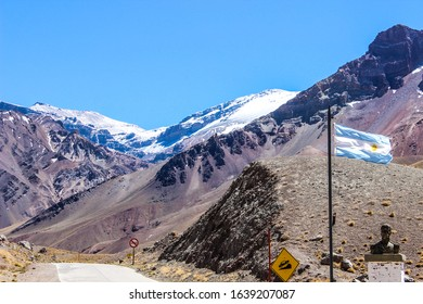 Aconcagua peak, the highest mountain in Argentina, the Andes and America. The Argentinian flag can be seen in the entrance of Aconcagua Provincial Park, in Mendoza