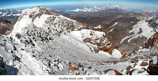 Aconcagua summit, looking down upper Canaleta chute at other mountaineers still ascending. The south peak can be seen on the left. Photo from summit, 6962 meters.