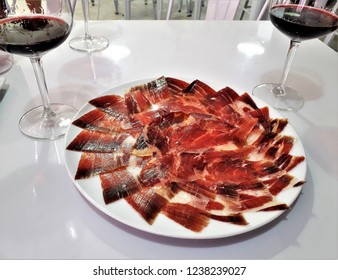 Acorn-fed Iberian ham table photograph, with wine, spain, tourism, tourist, advertising, travel, traveler, holidays, party, meet, tourist destination, know, travel,