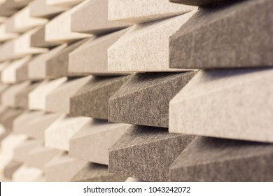acoustic foam wall pattern random color grey tone background.