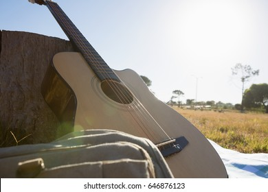 Acoustic guitar with bag in the park on a sunny day