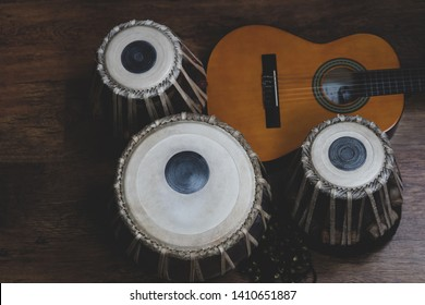 Acoustic guitar, cajon and tabla - view of the musical instruments used for fusion eastern and western music, and also jazz and blues.