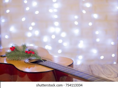 Acoustic guitar with christmas decoration.Christmas music background for text