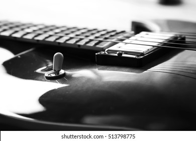Acoustic guitar close up in dark background