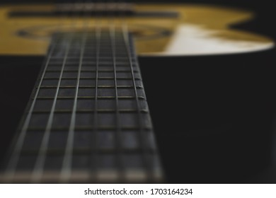 Acoustic guitar close up. musical instrument. strings on the guitar fretboard