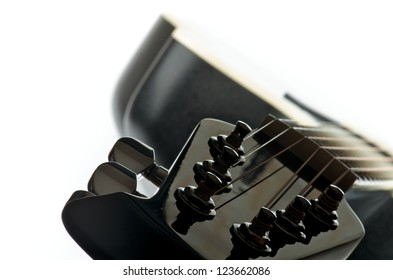 Acoustic Guitar. Focus on Fretboard closeup on white background