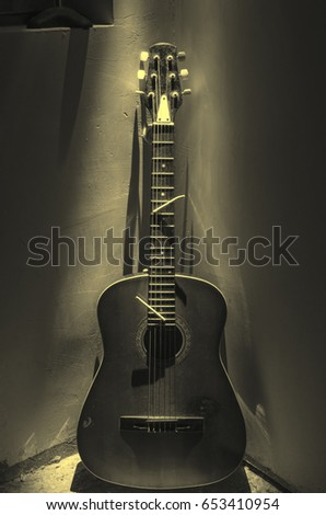 Acoustic Guitar Leaning On Rusty Wall Stock Photo (Edit Now