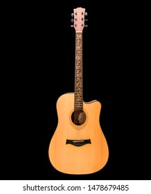 Acoustic guitar made of real wood on a black background