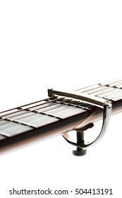 acoustic guitar neck with a capo
