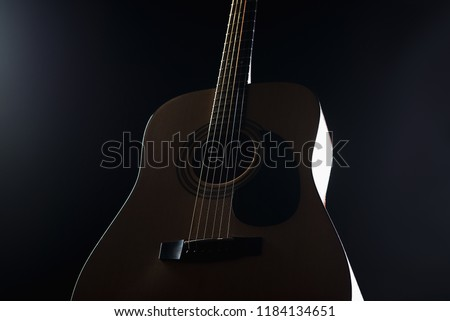 Acoustic Guitar On Black Background Stock Photo Edit Now