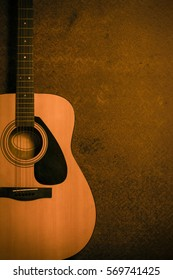 Acoustic guitar on old steel background