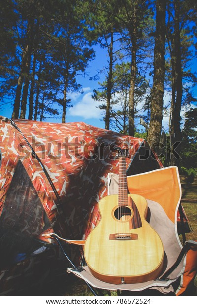 Wondrous Acoustic Guitar On Outdoor Folding Chair Stock Image Ocoug Best Dining Table And Chair Ideas Images Ocougorg