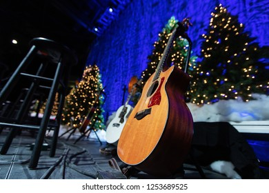 Acoustic guitar on stage during Christmas holiday concert