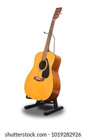 An acoustic guitar on a stand isolated on white background by pen tool with clipping paths