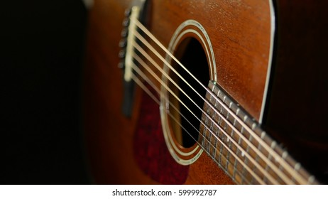 Acoustic guitar on wood background. Close up of music instrument