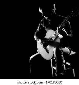 Acoustic guitar player guitarist. Classical guitar musical instrument concert playing in darkness