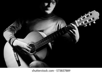 Acoustic guitar player guitarist Classical guitar musician playing musical instrument isolated on black