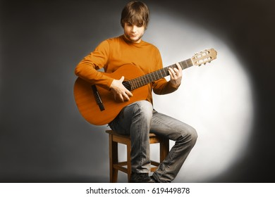 Acoustic guitar player. Guitarist playing spanish guitar. Man with music instrument