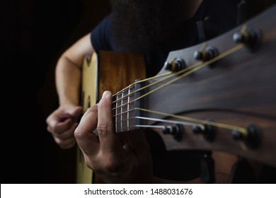 Acoustic Guitar Player Performing. Guitarist Playing In Music Studio