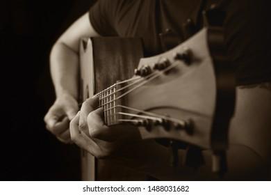 Acoustic Guitar Player Performing. Guitarist Playing In Music Studio