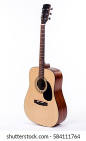 acoustic guitar standing upright isolated on a white background
