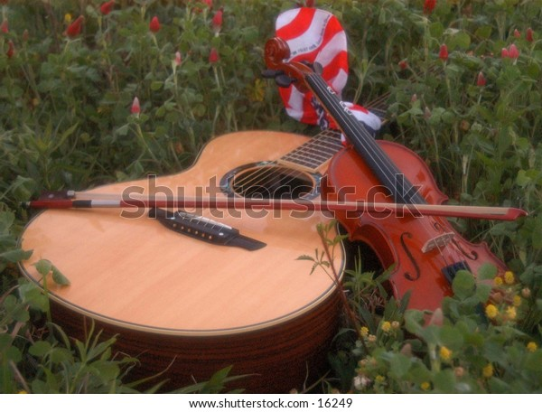 Acoustic Guitar Violin and American Flag