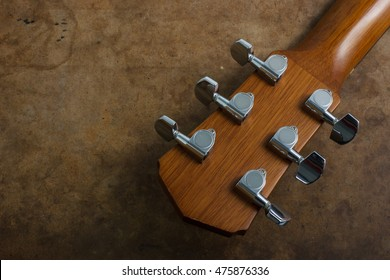 Acoustic guitarhead stock and tuner.