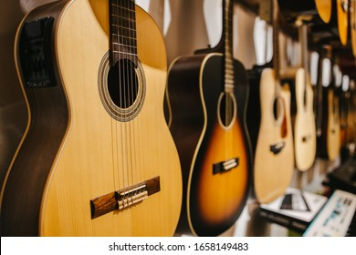 Acoustic guitars hung on a wall in a music shop
