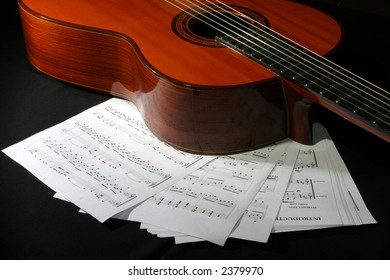 acoustic gutar with music sheets