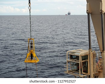 Acoustic subsea beacon is lifted by vessel crane and lowered down under the sea. This beacon is used to identify precise location of object under water using ultra sonic wave.