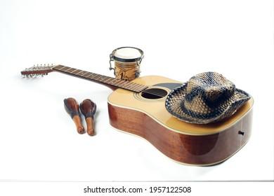 Acoustic twelve string guitar maracas bong hat isolated on white background