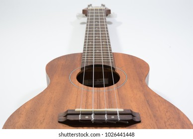 Acoustic wooden guitar ukulele with white background