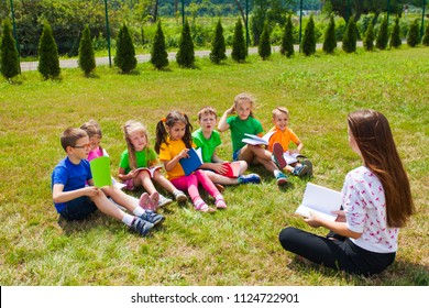 Acquaintance of the teacher and children outdoors