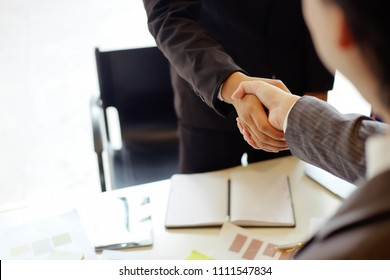 Acquisition concept, Business partnership shaking hands, finishing up meeting, business etiquette.