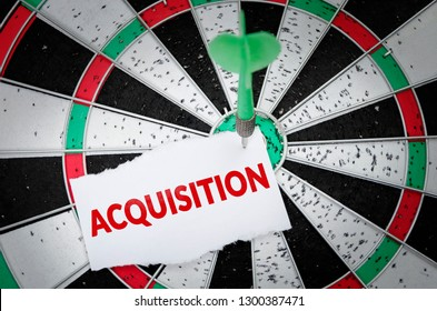 Acquisition note on notepaper with dart arrow and dart board. Marketing, advertisement, business concept.