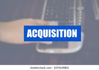 Acquisition word with business blurring background