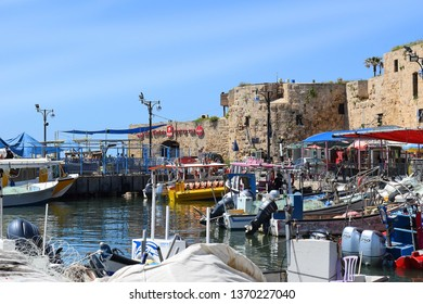 ACRE, ISRAEL - April 11, 2019: view on marina with yachts and fishing port in old city Acre, Israel