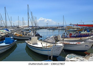 ACRE, ISRAEL - April 11, 2019: fishing boats in the old port of Acre, Israel