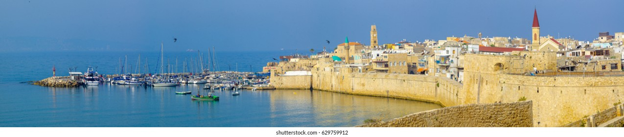 ACRE, ISRAEL - APRIL 27, 2017: Panoramic view of the city walls, the fishing harbor, and the old city skyline, in Acre (Akko), Israel