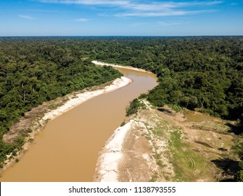 Acre state, Brazil. Aerial view of the Abuna River,  that divides the Brazilian and Bolivian Amazon border. It is a river of muddy waters that travels many miles between the two countries.