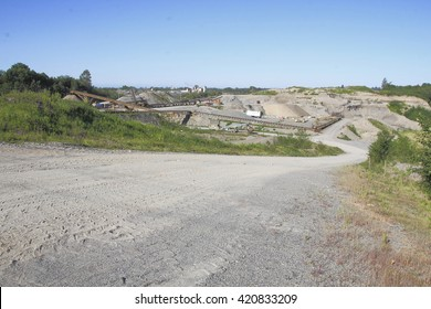 Acres of land have been carved up by a huge gravel pit/Major Industrial Open Gravel Pit/Acres of land have been carved up by a huge gravel pit.