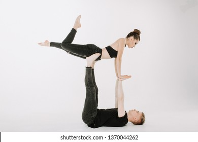 Acrobat Dancing Pose of Two Talented Young Dancer. Beautiful Caucasian Dance Couple Wear Black Balance Isolated on White Background. Sensual Professional Man and Woman Perfomer Side View