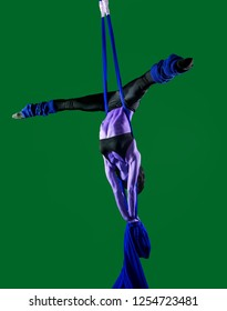 Acrobat on the fabric on a green background. The figure in a blue color. Gymnast in the air. Athlete and exercises. Sport.