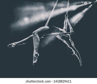 acrobat on a trapeze in black and white