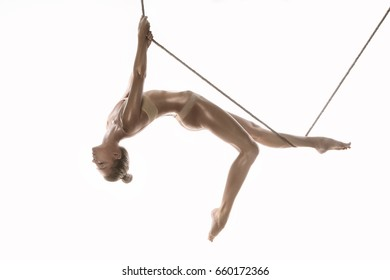 Acrobat with rope on white background