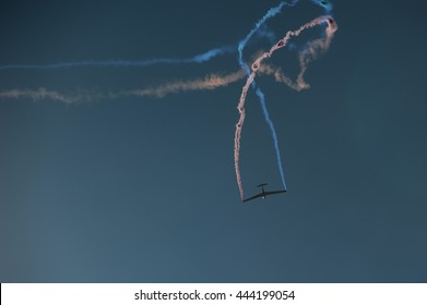 Acrobatic Glider (sailplane) flying on clear blue sky