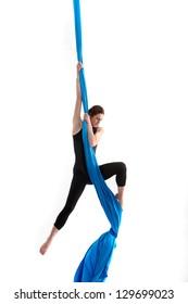 Acrobatic woman on silk tissue
