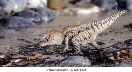 Acrocanthosaurus on the river- model toy